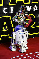 C3-P0 & R2-D2 on the Red Carpet during the STAR WARS: 'The Force Awakens' EUROPEAN PREMIERE at Odeon, Empire & Vue Cinemas, Leicester Square, England on 16 December 2015. Photo by David Horn / PRiME Media Images