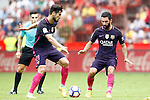 FC Barcelona's Andre Gomes (l) and Arda Turan during La Liga match. September 24,2016. (ALTERPHOTOS/Acero)
