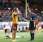 Motherwell's Fraser Kerr booked by referee Willie Collum after conceding a penalty kick