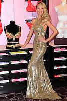 NEW YORK, NY - NOVEMBER 06: Victoria's Secret Angel Candice Swanepoel Shows Off The $10 Million Royal Fantasy Bra at Victoria's Secret Herald Square on November 6, 2013 in New York City. (Photo by Jeffery Duran/Celebrity Monitor)