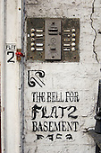 Doorbells on a decaying house in multiple occupation in Fitzrovia, central London.