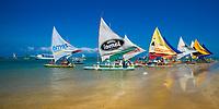 Porto de Galinhas, typical, colorful Ipojuca boats, reflected on the sandy Atlantic Ocean beach in Pernambuco, near Recife Brazil