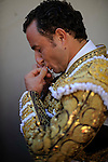 Spanish Matador Javier Rubio kisses his cross before taking part in a bullfight of the San Fermin festival at Pamplona's bullring on July 8, 2012, in Pamplona, northern Spain. The festival is a symbol of Spanish culture that attracts thousands of tourists to watch the bull runs despite heavy condemnation from animal rights groups . (c) Pedro ARMESTRE