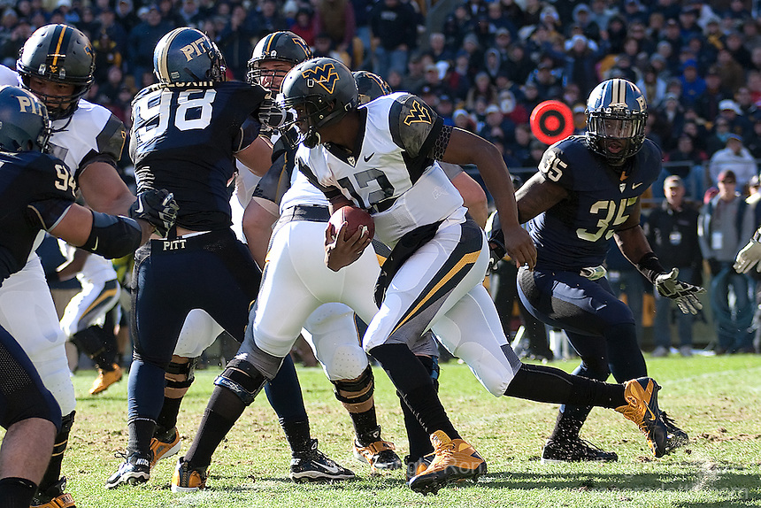 WVU quarterback Geno Smith (12) takes off on a run. The WVU Mountaineers defeated the Pitt Panthers 35-10 at Heinz Field, Pittsburgh, Pennsylvania on November 26, 2010.