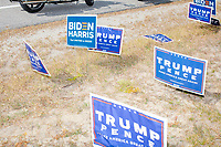 A collection of Trump/Pence campaign signs, and a few Biden/Harris signs, stand by the roadside before Donald Trump, Jr., son of president Donald Trump and a rising Republican political star, speaks at an outdoor campaign rally at The Lobster Trap in North Conway, New Hampshire, on Thu., Sept. 24, 2020.