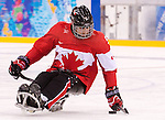 Sochi, RUSSIA - Mar 13 2014 - Kevin Rempel as Canada takes on USA in Sledge Hockey Semi-Final at the 2014 Paralympic Winter Games in Sochi, Russia.  (Photo: Matthew Murnaghan/Canadian Paralympic Committee)
