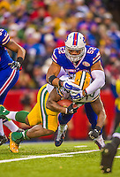 14 December 2014: Green Bay Packers running back Eddie Lacy (27) goes up the middle and is tackled by Buffalo Bills outside linebacker Preston Brown (52) after a 4-yard gain in the third quarter at Ralph Wilson Stadium in Orchard Park, NY. The Bills defeated the Packers 21-13, snapping the Packers' 5-game winning streak and keeping the Bills' 2014 playoff hopes alive. Mandatory Credit: Ed Wolfstein Photo *** RAW (NEF) Image File Available ***