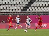 KASHIMA, JAPAN - AUGUST 2: Rose Lavelle #16 of the USWNT dribbles during a game between Canada and USWNT at Kashima Soccer Stadium on August 2, 2021 in Kashima, Japan.