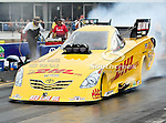 Jeff Arend #170, driver for DHL Toyota Solara's Funny Car heating up the slicks before making a qualifying run at the O'Reilly Fall Nationals held at the Texas Motorplex in  Ennis, Texas.