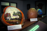 Painted coconut at The Father Damien museum, located behind St. Augustine By The Sea Church on the beach in Waikiki