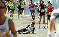 A runner is struck down with cramp during the New York marathon.