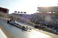 Jun. 15, 2012; Bristol, TN, USA: NHRA top fuel dragster driver Antron Brown (near lane) races alongside Morgan Lucas during qualifying for the Thunder Valley Nationals at Bristol Dragway. Mandatory Credit: Mark J. Rebilas-