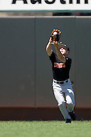 Oklahoma State  outfielder Josh Botts makes a catch against the Texas Longhorns on Sunday April 25th, 2010 at UFCU Dish-Falk Field in Austin, Texas.  (Photo by Andrew Woolley / Four Seam Images)
