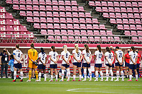 KASHIMA, JAPAN - AUGUST 2: United States stadning for the national anthem before a game between Canada and USWNT at Kashima Soccer Stadium on August 2, 2021 in Kashima, Japan.