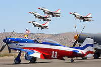 Four F-16C Falcons of the United State Air Force Thunderbirds take to the air while the P-51D Mustang Unlimited Air Racer 'Miss America' waits on the ramp during the 2008 National Championship Air Races at Stead Field, Nevada.