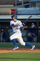 Jose Martinez (2) of the Burlington Royals follows through on his swing against the Bluefield Blue Jays at Burlington Athletic Park on June 29, 2015 in Burlington, North Carolina.  The Royals defeated the Blue Jays 4-1. (Brian Westerholt/Four Seam Images)
