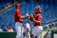 Clearwater Threshers relief pitcher Connor Brogdon (44) shakes hands with catcher Colby Fitch (10) after closing out a Florida State League game against the Florida Fire Frogs on April 24, 2019 at Spectrum Field in Clearwater, Florida.  Clearwater defeated Florida 13-1.  (Mike Janes/Four Seam Images)
