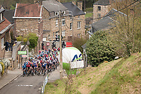 peloton on the first ascent up the infamous Mur de Huy<br /> <br /> 85th La Flèche Wallonne 2021 (1.UWT)<br /> 1 day race from Charleroi to the Mur de Huy (BEL): 194km<br /> <br /> ©kramon