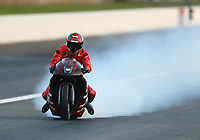 Sep 5, 2020; Clermont, Indiana, United States; NHRA pro stock motorcycle rider Matt Smith slides after blowing an engine and locking up the rear wheel after winning the Pro Bike Battle during qualifying for the US Nationals at Lucas Oil Raceway. Mandatory Credit: Mark J. Rebilas-USA TODAY Sports