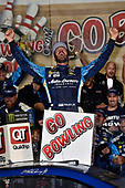 Monster Energy NASCAR Cup Series<br /> Go Bowling 400<br /> Kansas Speedway, Kansas City, KS USA<br /> Saturday 13 May 2017<br /> Martin Truex Jr, Furniture Row Racing, Auto-Owners Insurance Toyota Camry celebrates is win in Victory Lane<br /> World Copyright: Nigel Kinrade<br /> LAT Images<br /> ref: Digital Image 17KAN1nk09954
