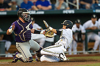 Vanderbilt Commodores outfielder Jeren Kendall (3) slides home against TCU Horned Frogs catcher Evan Skoug (9) in Game 12 of the NCAA College World Series on June 19, 2015 at TD Ameritrade Park in Omaha, Nebraska. The Commodores defeated TCU 7-1. (Andrew Woolley/Four Seam Images)