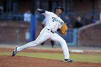 Asheville Tourists starting pitcher Johendi Jiminian #31 delivers a pitch during game two of a double header against the West Virginia Power at McCormick Field on April 8, 2014 in Asheville, North Carolina. The Tourists defeated the Power 5-2. (Tony Farlow/Four Seam Images)