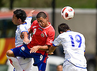 John Ruiz (9) of Costa Rica goes up for a header with Kevin Barahona (16) and Giovanny Zavaleta (19) of El Salvador during the group stage of the CONCACAF Men's Under 17 Championship at Jarrett Park in Montego Bay, Jamaica. Costa Rica defeated El Salvador, 3-2.