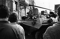 LETTLAND, 20.08.1991.Riga.Waehrend des Anti-Gorbatschow-Putsches versuchen sowjetische Truppen, die Kontrolle ?ber Riga zu erhalten, mit dem Scheitern des Putsches gewinnt Lettland endgueltig seine Unabhaengigkeit. Ð Marodierende sowjetische OMON-Sondertruppen fahren mit ihren Panzerwagen durch die demonstrierende Menschenmenge auf dem Domplatz, um Angst und Schrecken zu verbreiten. Hier steht auch das von Sowjettruppen besetzte Rundfunkgebaeude..During the anti-Gorbachev-coup Soviet troops try to obtain control of Riga. With the failure of the coup Latvia finally regains its independence. - Soviet OMON special units driving through the demonstrators at the cathedral square in order to spread panic. Here also the occupied public radio central is located..© Martin Fejer/EST&OST
