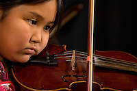 A young girl plays the violin during a Chinese New Year Celebration at UNC Charlotte in Charlotte, NC.