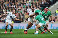Manu Tuilagi of England runs into Jonathan Sexton as Bundee Aki of Ireland supports during the Guinness Six Nations match between England and Ireland at Twickenham Stadium on Sunday 23rd February 2020 (Photo by Rob Munro/Stewart Communications)