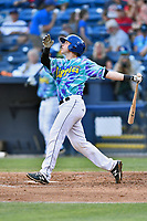 Asheville Hippies catcher Brian Serven (25) swings at a pitch during a game against the Greenville Drive at McCormick Field on June 29, 2017 in Asheville, North Carolina. The Drive defeated the Tourists 9-6. (Tony Farlow/Four Seam Images)