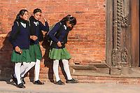 Nepal, Patan.  Three Nepali Girls Walking Home After School.