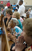 Women pray in catholic church, Nova Friburgo cathedral, Rio de Janeiro State, Brazil.