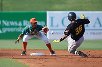 Greensboro Grasshoppers shortstop Osiris Johnson (1) fields a throw as Raul Hernandez (36) of the West Virginia Power slides into second base at First National Bank Field on August 9, 2018 in Greensboro, North Carolina. The Power defeated the Grasshoppers 5-3 in game one of a double-header. (Brian Westerholt/Four Seam Images)