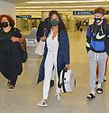 MIAMI, FL - JULY 15: (EXCLUSIVE COVERAGE) Garcelle Beauvais (C) is seen at Miami International Airport with her son Jax Joseph Nilon on July 15, 2021 in Miami, Florida.  (Photo by Vallery Jean / jlnphotography.com )