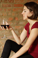 Montreal (Qc) CANADA - July 2008 File Photo-<br /> Model and Property released photo of a young woman drinking red wine