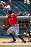 Willy Garcia (18) of the Indianapolis Indians follows through on his swing against the Charlotte Knights at BB&T BallPark on June 21, 2015 in Charlotte, North Carolina.  The Knights defeated the Indians 13-1.  (Brian Westerholt/Four Seam Images)