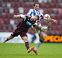 Hearts' Scott Robinson and Killie's Manuel Pascali challenge for the ball.