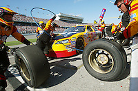 Rookie Scott Wimmer's pit crew goes to work on his car during a pit stop during the Daytona 500 Sunday february 15, 2004.(Kelly Jordan)