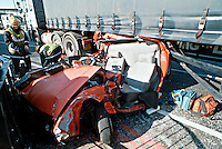 Remains of a car involved in a RTA with an HGV. The Car as it tried to pass down the nearside of an articulated lorry as it went around a corner trapping the driver. Firefighters used hydraulic cutting equipment to extricate the driver. This image may only be used to portray the subject in a positive manner..©shoutpictures.com..john@shoutpictures.com