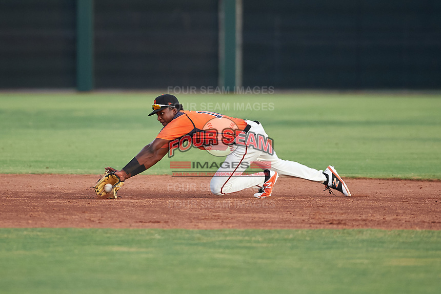 AZL Giants Orange shortstop Marco Luciano (10) makes a diving stop during an Arizona League game against the AZL Mariners on July 18, 2019 at the Giants Baseball Complex in Scottsdale, Arizona. The AZL Giants Orange defeated the AZL Mariners 7-4. (Zachary Lucy/Four Seam Images)