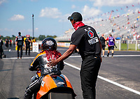 Aug 9, 2020; Clermont, Indiana, USA; Antron Brown (right) talks with NHRA pro stock motorcycle rider Angelle Sampey during the Indy Nationals at Lucas Oil Raceway. Mandatory Credit: Mark J. Rebilas-USA TODAY Sports