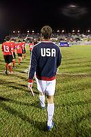 Zachary Carroll (17) of the United States walks onto the field during the finals of the CONCACAF Men's Under 17 Championship at Catherine Hall Stadium in Montego Bay, Jamaica. The United States defeated Canada, 3-0, in overtime