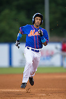 Raphael Ramirez (21) of the Kingsport Mets legs out a triple against the Elizabethton Twins at Hunter Wright Stadium on July 8, 2015 in Kingsport, Tennessee.  The Mets defeated the Twins 8-2. (Brian Westerholt/Four Seam Images)