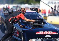 Aug 21, 2016; Brainerd, MN, USA; A crew member for NHRA funny car driver Brian Stewart during the Lucas Oil Nationals at Brainerd International Raceway. Mandatory Credit: Mark J. Rebilas-USA TODAY Sports