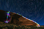 """Pictured:  An 8 minutes 30 seconds exposure at Looking Glass Arch, Moab, UT<br /> <br /> Bright bolts of colourful light snake their way across mountains and cliffs.  The striking images were created by a rock climber who wrapped LED lights around his body before capturing long exposure shots of his route.<br /> <br /> Luke Rasmussen took the photos in the deserts of Nevada, in the United States, and admits that his method of 'freezing time in a moment' is unusual.  The 28 year old photographer said: """"Wearing a sweater full of lights and climbing through the darkness of night is certainly a different experience than most climbers will get.  SEE OUR COPY FOR DETAILS.<br /> <br /> Please byline: Luke Rasmussen/Solent News<br /> <br /> © Luke Rasmussen/Solent News & Photo Agency<br /> UK +44 (0) 2380 458800"""