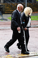 Pictured: Avril Griffiths (R) and Peter Griffiths (L), leaving Cardiff Crown Court after an earlier hearing.<br /> Re: Avril Griffiths, 61, and Peter Griffiths, 65, from Barry, have been found guilty of rape, indecent assault and taking indecent photographs of a child.