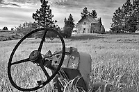 Old tractor and abandoned farm home. Near Flora. Oregon