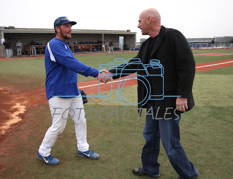 Matt Williams shakes hands with the Wildcats catcher after throwing out the first pitch in the season-opener doubleheader against South Mountain Community College at WNC in Carson City, Nev., on Friday, Jan. 25, 2013..Photo by Cathleen Allison