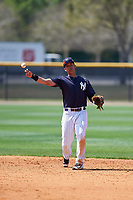 New York Yankees Oswaldo Cabrera (9) throws to first base during a minor league Spring Training game against the Detroit Tigers on March 22, 2017 at the Yankees Complex in Tampa, Florida.  (Mike Janes/Four Seam Images)